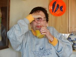 Holding My Nose to Drink Orange Juice.  © Norine Dresser photo collection, 2013.