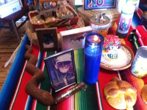 Partial view of altar with  Harold Dresser's photo and cigar.  © Norine Dresser photo collection, 2013.