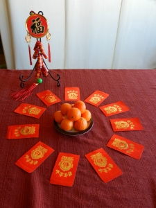Chinese good luck symbols; tangerines; red envelopes with money inside; firecrackers.  © photo collection & text, 2013.