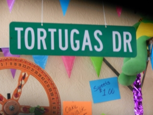 Sign inside Tortugas Festival Pavillion.  Norine Dresser photo collection, 2014.