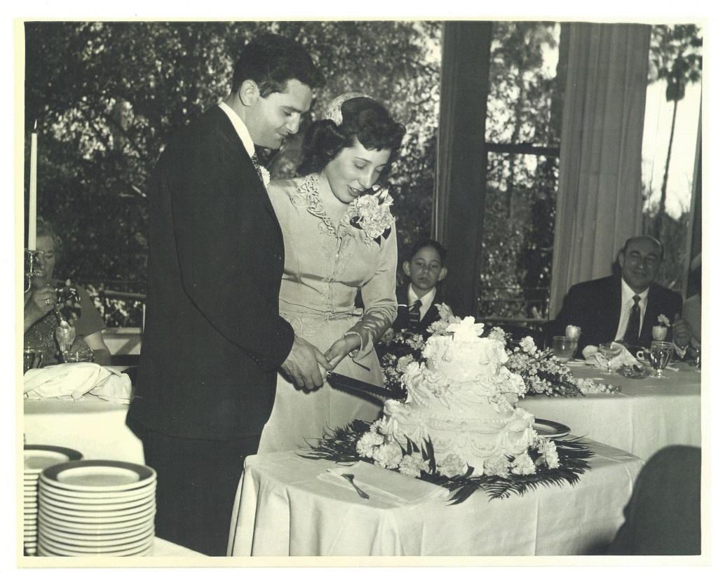 March 4, 1951.  Harold & Norine cutting their wedding cake. © Norine Dresser photo collection, 2014.