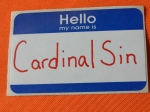 Cardinal Sin name tag.  © Norine Dresser photo collection, 2014
