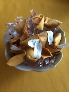 Bowl of opened fortune cookies.  Photo by Mariah Chase.  © Norine Dresser photo collection, 2014.