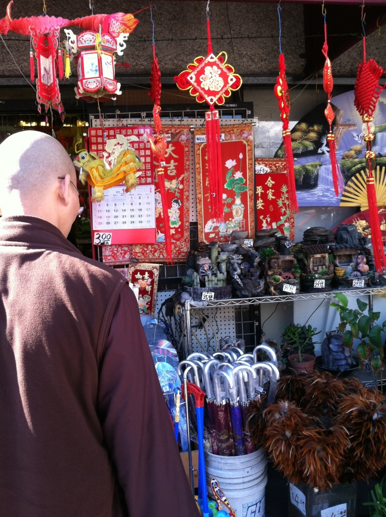 Chinese monk shopping for New Year's.  L. A. Chinatown.  © Norine Dresser photo collection, 2015.