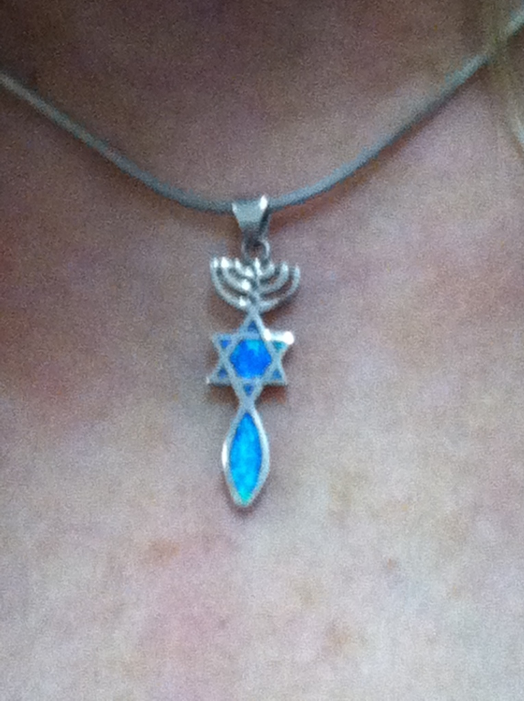 Recurring symbol of fish, Star of David and menorah, worn as a necklace.  © Norine Dresser photo collection, 2015.