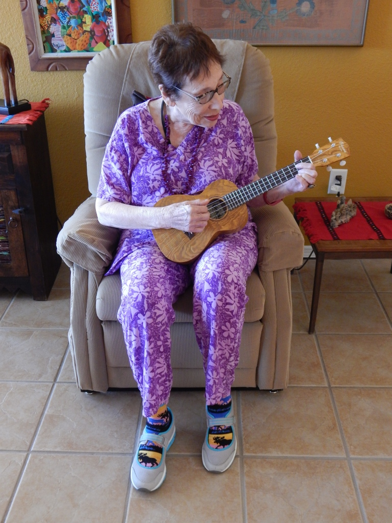 Novice playing the ukelele.  Photo by Mariah Chase. ©Norine Dresser photo collection, 2015.