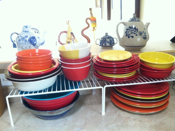 Dishes stacked on the counter.  ©Norine Dresser photo collection, 2015.