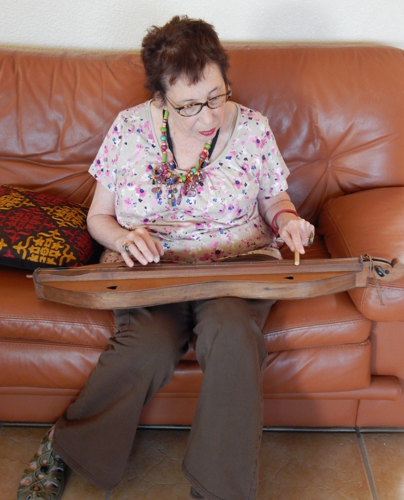 Norine Dresser playing her own Mountain Dulcimer. Photo by Mariah Chase. © Norine Dresser photo collection, 2015.