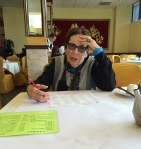 Contemplating dim sum in Oakland, CA, 2016. Photo by Mariah Chase. © Norine Dresser photo collection, 2016