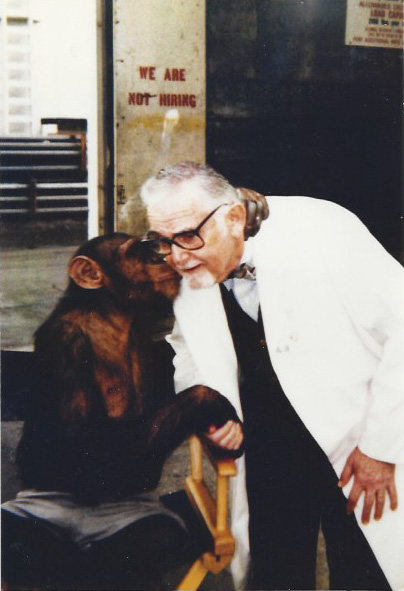 Harold working as an extra in a Pepsi ad with a chimp. © Norine Dresser photo collection, 2017.