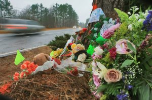 090126 - Kennesaw - Friends and fellow students of Garrett Reed, 16 gathered at the scene of roadside memorial Monday morning, January 26, 2009 at Sylvia Drive and Midway Road where he died early Sunday morning. Drive and hit another car about 12:30 a.m. Saturday, Cobb County police Sgt. Dana Pierce said. Reed died at the scene. The other driver, Richard Reyes, 25, of Dallas, was taken to Wellstar Kennestone Hospital in stable condition, Pierce said. The wreck happened less than a mile from Harrison High School, where Reed was a junior wide receiver and defensive back on the football team. Reed was the second Harrison athlete to be killed in a wreck in recent years. Luke Abbate, a junior on the school's lacrosse team, was killed, and four of his teammates injured, in a February, 2006 crash. The funeral for Reed will be at 2 p.m. Tuesday at First Baptist Church in Powder Springs. Visitation is scheduled for 6 to 9 p.m. Monday at West Cobb Funeral Home. jspink@ajc.com