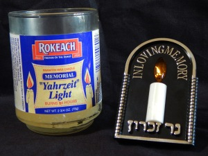 Two examples of yahrzeit lights: traditional candle, electrical. Photo by Mariah Chase. © Norine Dresser photo collection, 2017.