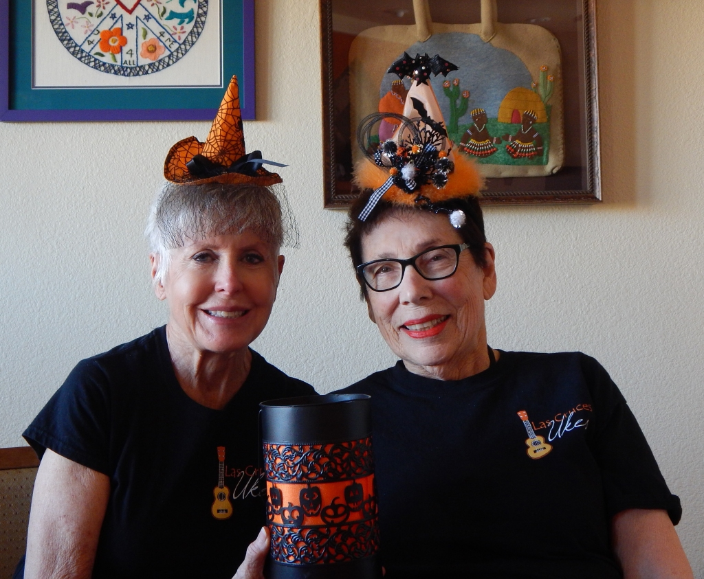 Roxana Gillett and I in our Halloween hats to sing a seasonal parody to the tune of the Addams Family theme song. Photo by Mariah Chase. © Norine Dresser photo collection, 2017.
