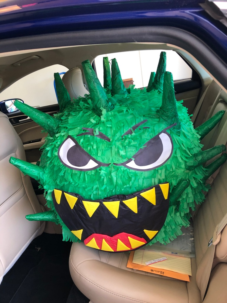 I purchased this Covid-19 piñata from a piñata and popsicle shop here in Las Cruces, NM. Since no face-to-face parties are safe during the pandemic, I am hoping to smash it in October 2021, at my 90th birthday party. Hopefully, by then we will have a safe vaccine available. © Norine Dresser photo collection, 2021.